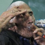 Banos smokes a cigar in his house during his 111th birthday celebration in Havana